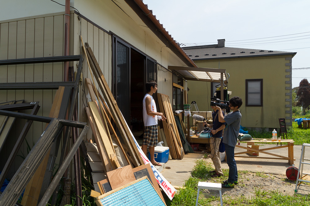Mr. Yoshida, who is giving an interview.